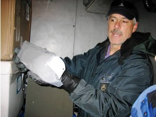 Penn State's Todd Sowers presents an ice core
